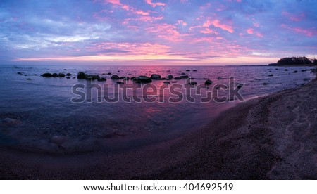 Dawn on the sea coast, bright, fiery sunrise, panorama #404692549