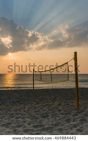 Dawn on the sea for texture or background. Volleyball court, a volleyball net on the beach. #469884443