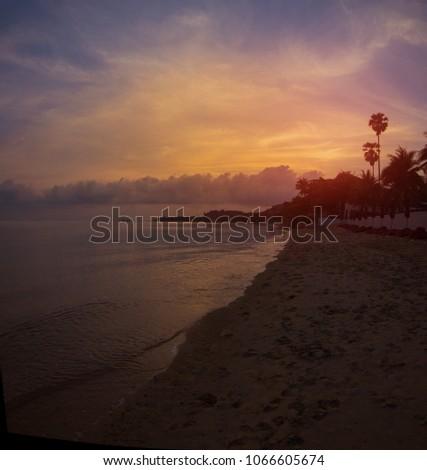 Dawn or sunset on the beach near the sea