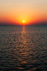 Dawn or sunset on the sea, the ocean, the lake. Beautiful view. The sun is visible.