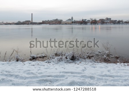 Dawn over the city of Irkutsk on the river bank in the fall.
