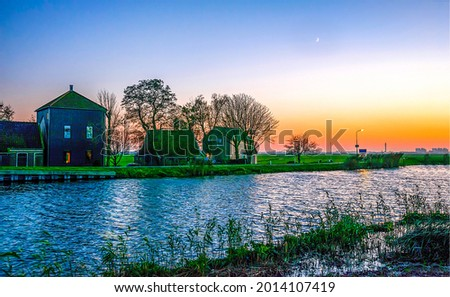 Dawn over the river houses. River house at sunrise. River house at dawn