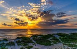 Dawn over the sea horizon. Beautiful sunrise ove sea. Sunrise sea landscape. Sea sky at dawn
