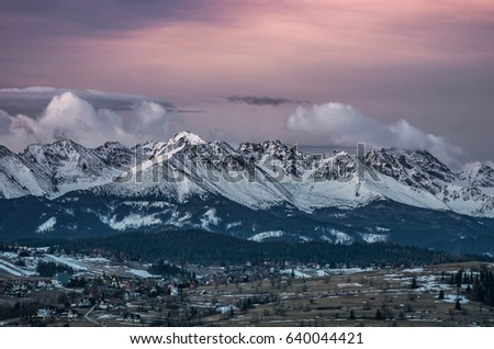 Dawn panorama of snowyTatra Mountains, Poland landscape #640044421