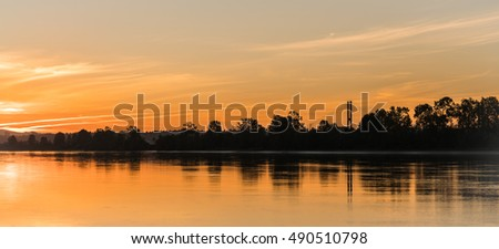 stock-photo-dawn-sky-and-reflection-at-f