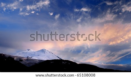 Dawning in blue and rose tone on snow mountain. Natural composition