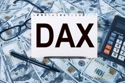 DAX . text on white paper on the background of calculator and money bills