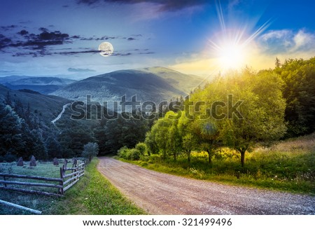 day and night collage landscape. fence near road going down the hill through meadow and forest to the high mountains with sun and moon