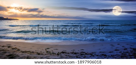 day and night time change concept at the seaside in summer. beautiful seascape with sun and moon. calm waves wash the golden sandy beach. fluffy clouds on the sky Stock photo ©