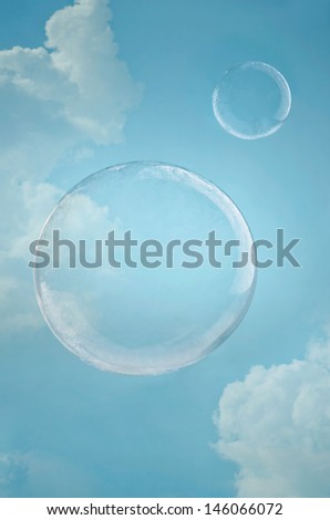 Day dreaming. Two floating soap bubbles against blue sky with copy space