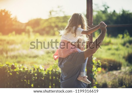 Day for fun. Grandfather and granddaughter spending time together in nature. Carrying on shoulders. Copy space. Foto stock ©