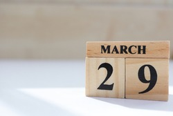 Day 29 of March month, Wooden calendar with date.