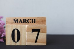 Day 7 of March month, Wooden calendar with date. Empty space for text.