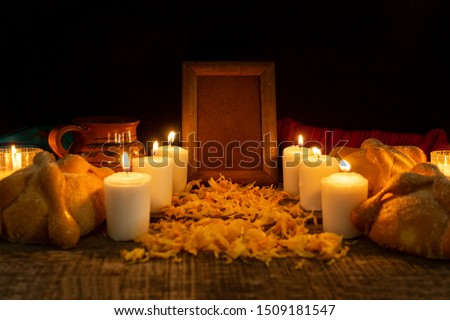 Day of the dead altar with bread and candles