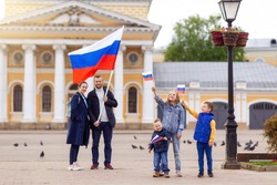 Day of the Russian Federation flag . Big friendly young full traditional Russians family holds flag. Patriots patriotism citizens nationality. Happy celebrate. 12 June. August 22 holiday.  November 4