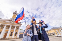 Day of the Russian flag of Russia concept. Big friendly full traditional Russians family holds flag. Patriots patriotism citizens nationality. Happy celebrate. 12 June. August 22 holiday.  November 4