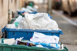 Day view plastice waste refuse bins boxes on British road
