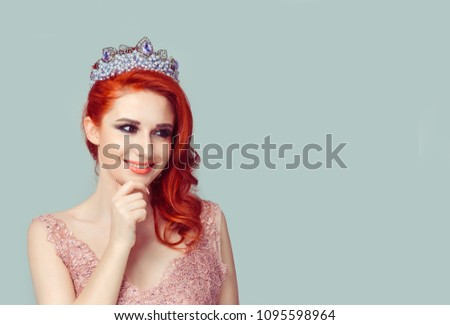 Daydream. Beauty queen girl woman actress miss dreaming about winning in a contest bright future career hoping for the best success looking up to side smiling hands on face. Full makeup pastel color