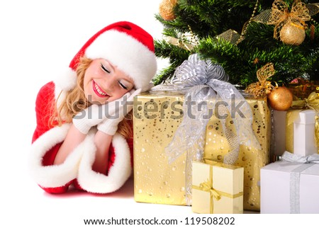 Daydreamed christmas santa girl with gifts and decorated fir-tree.