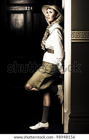 Daydreaming Female Explorer In Safari Clothing Waiting Outside A Hotel Room Just Before Her Journey Into The Savannah, In A Travel Adventure Awaits Conceptual