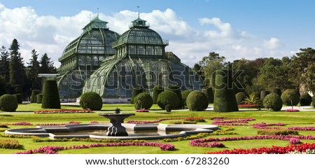 Daylight image of the famous Palmenhaus ( palm house or greenhouse) at the imperial garden of Schoenbrunn of Vienna - Austria