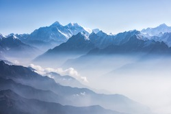 Daylight view of Mount Everest, Lhotse and Nuptse and the rest of Himalayan range from air. Sagarmatha National Park, Khumbu valley, Nepal.