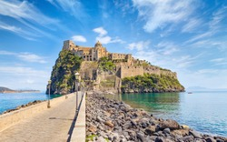Daylight view road to Aragonese Castle or Castello Aragonese - famous landmark and tourist destination near Ischia island, Italy.