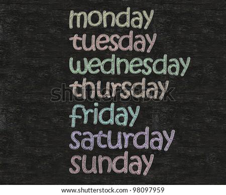 days of the week written on blackboard background