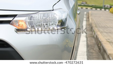 Daytime Running Light. Headlight LED daytime light for car. Lighting standards for cars and safety of motorists. #470272631