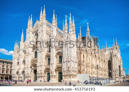Daytime view of famous Milan Cathedral (Duomo di Milano) on piazza in Milan, Italy  #453756193