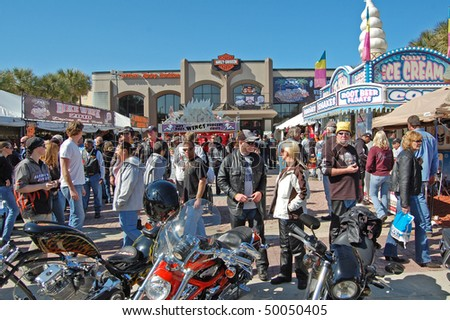 "DAYTONA BEACH, FL - MARCH 6:  Crowd in front of the Harley-Davidson Motorcycle Dealership on Main Street during ""Bike Week 2010"" in Daytona Beach, Florida."