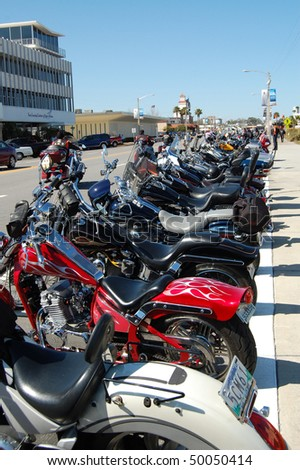 "DAYTONA BEACH, FL - MARCH 6:  Motorcycles line Beach Street for miles during during ""Bike Week 2010"" in downtown Daytona Beach, Florida. - stock photo"