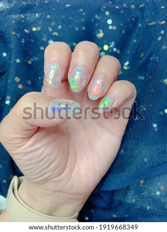 Dazzling aurora nail design in several colors Stock photo ©