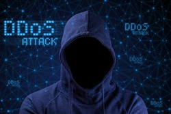DDos attack.  Hacker on the background of computer networks.  Cybersecurity.