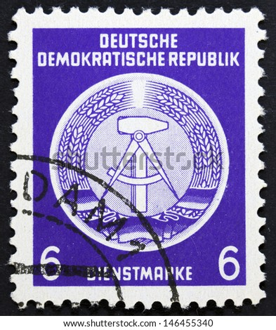 """DDR - CIRCA 1952: A Stamp printed in GDR (German Democratic Republic - East Germany) shows DDR national coat of arms with inscription """"Service Stamp"""", series """"GDRs national coat of arms"""", circa 1952"""