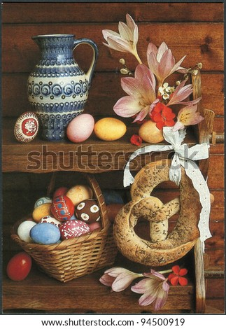DDR - CIRCA 1970: Reproduction of an old postcard, easter postcard depicts flowers, a bagel, a basket, and painted eggs, circa 1970