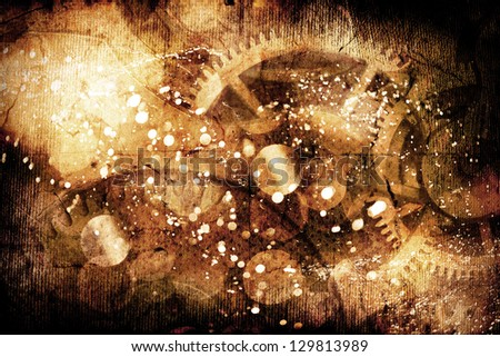 De-focused abstract background with detail of clock cogs