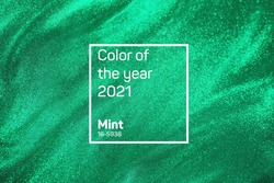 De-focused abstract elegant, detailed green mint glitter particles backdrop. Holiday magic shimmering luxury background. 2021 color trend