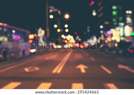 De focused/blur image of city at night. De focused, blurred urban abstract traffic background.