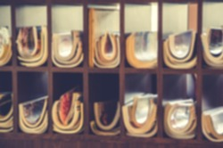 De focused/Blurred image of a magazine stand in a cafe. Vintage effect.