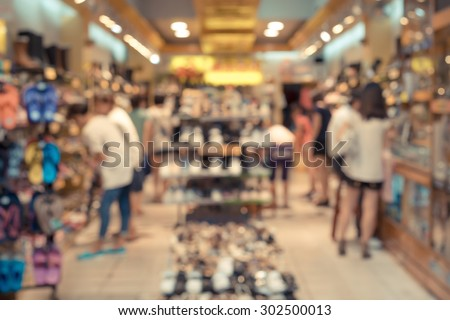 De focused/Blurred image of a shoe store with customers in it.