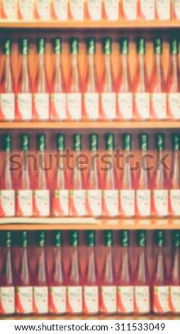 De focused/Blurred image of rows of glass bottled juice. #311533049