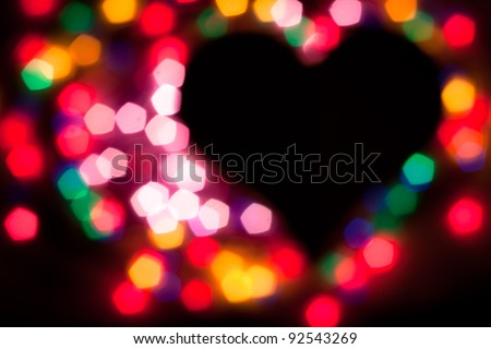 De-focused colorful lights in heart shape. No focus!