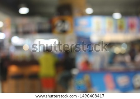 De focused image of people that shopping in the department store. Blurry and bokeh light effect in the city. Selective focus.