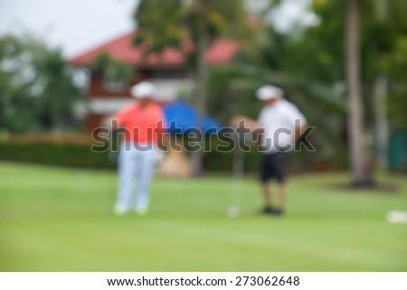 De focused or blurred men talking during golf game for background