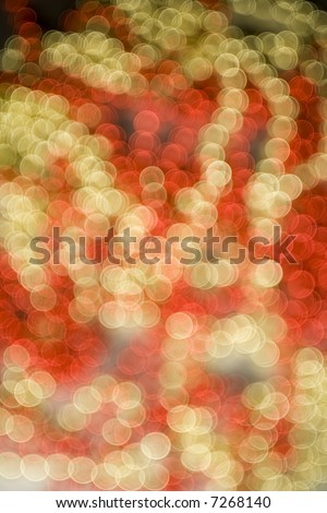 De-focused shimmering dots in Festive Christmas colours, created in-camera with a wide open apperture and a seriously de-focused lens, great background or texture for festive design element.