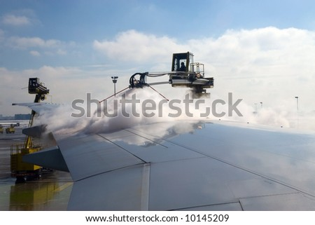De-ice airplane during winter before takeoff.