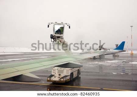 De-icing an aircraft before takeoff