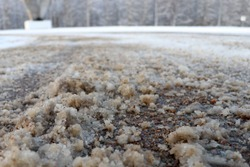 De-icing chemicals and sand on the winter road