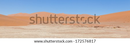 Stock Photo Dead acacia trees and red dunes of Namib desert, Deadvlei (Sossusvlei), Namibia